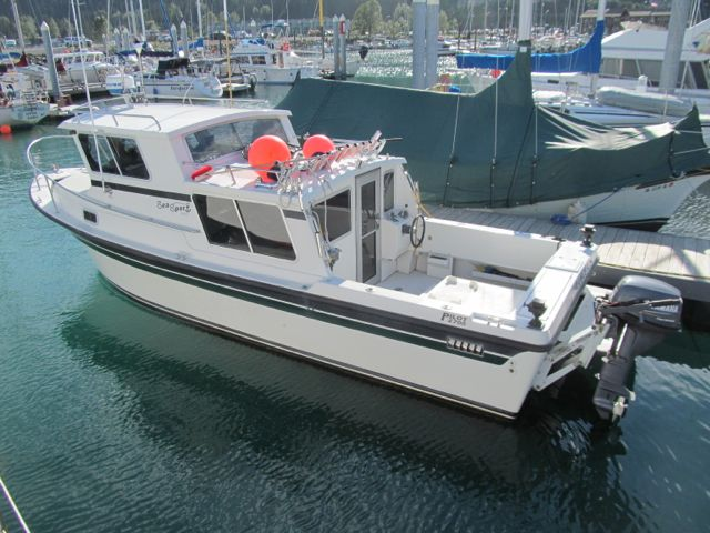 JUST REDUCED SEA SPORT PILOT 2700.  VOLVO 44, (2) STATION EVC CONTROLS, GALLEY, TRAILER.  $89,000